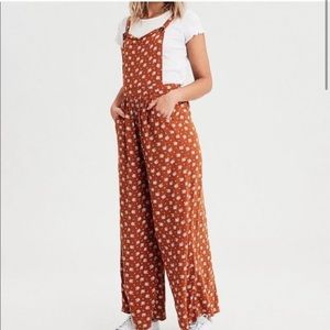 American Eagle soft floral mustard overalls